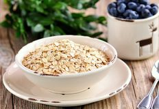 Oat flakes Quick cooking with blueberries. Healthy breakfast. Royalty Free Stock Photo