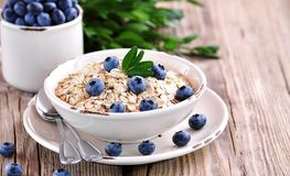 Oat flakes Quick cooking with blueberries. Healthy breakfast. Royalty Free Stock Photos