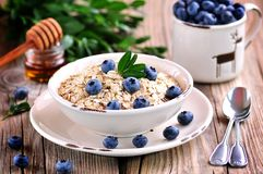 Oat flakes Quick cooking with blueberries. Healthy breakfast. Stock Photo