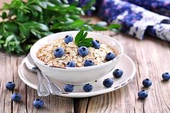 Oat flakes Quick cooking with blueberries. Healthy breakfast. Stock Photography