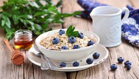 Oat flakes Quick cooking with blueberries. Healthy breakfast. Stock Photos