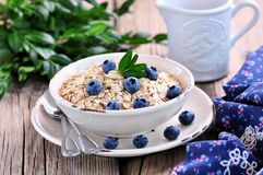 Oat flakes Quick cooking with blueberries. Healthy breakfast. Royalty Free Stock Images