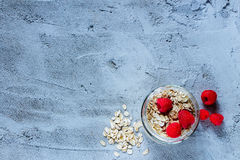 Oat flakes and raspberries Stock Photo