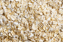 Oat flakes raw food ingredient texture. Macro close up detailed Royalty Free Stock Image