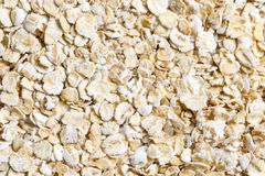 Oat flakes raw food ingredient texture. Macro close up detailed Royalty Free Stock Photography