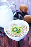 Oat flakes. Raw oat flakes in the white bowl Royalty Free Stock Photos
