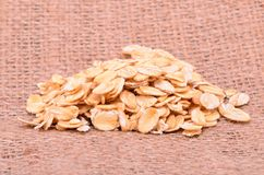 Oat flakes on sackcloth Stock Image