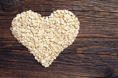 Oat flakes in a shape of heart Royalty Free Stock Photos