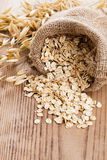 Oat flakes spilling Royalty Free Stock Images