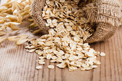Oat flakes spilling Royalty Free Stock Image