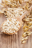 Oat flakes in spoon Stock Photo