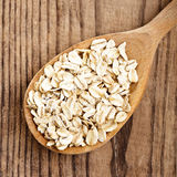 Oat flakes in spoon Royalty Free Stock Photos