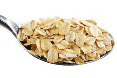 Oat flakes in spoon Royalty Free Stock Photo