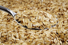 Oat flakes in spoon Royalty Free Stock Photography