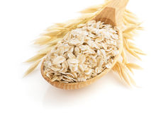 Oat flakes in spoon on white Stock Photography