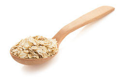 Oat flakes in spoon on white Stock Images