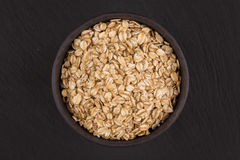 oat flakes in stone bowl Stock Image