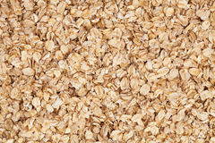 Oat flakes. Texture tile pattern background Stock Photography