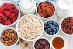 Oat flakes and various delicious ingredients for breakfast Royalty Free Stock Image