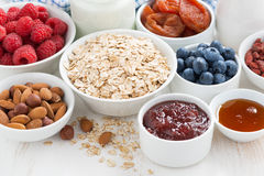 Oat flakes and various ingredients for breakfast, close-up Stock Photos