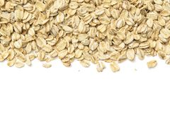 Oat flakes on white background stock photography