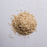 Oat flakes on white table Stock Photo