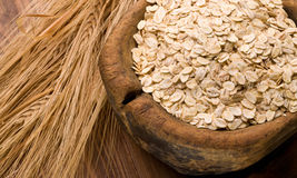 Oat flakes on wood Royalty Free Stock Images