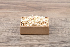 Oat flakes on wood Stock Photo