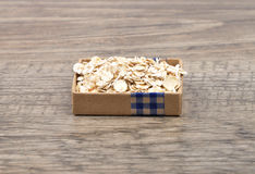 Oat flakes on wood. Colorful and crisp image of oat flakes on wood Royalty Free Stock Photos