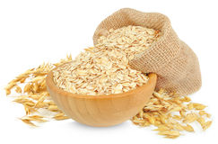 Oat flakes. In a wooden bowl isolated on white Royalty Free Stock Photos