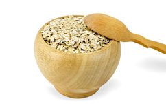 Oat flakes in a wooden bowl with a spoon Royalty Free Stock Photo