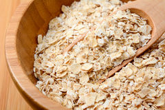 Oat flakes in wooden bowl Stock Photos