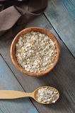 Oat flakes in wooden bowl Royalty Free Stock Photo