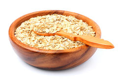 Oat flakes in a wooden bowl with spoon. Royalty Free Stock Images