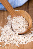 Oat flakes in wooden spoon Stock Image