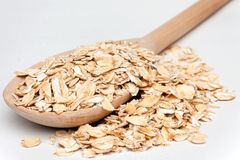 Oat-flakes with a wooden spoon Royalty Free Stock Image