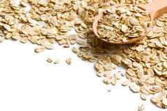 Oat flakes on a wooden spoon Stock Images