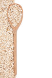 Oat-flakes with a wooden spoon Royalty Free Stock Photo