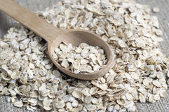 Oat flakes in wooden spoon Royalty Free Stock Image