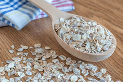 Oat flakes in wooden spoon Stock Photography
