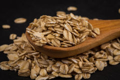 Oat flakes on a wooden spoon Stock Photo