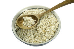 Oat flakes on a wooden spoon Royalty Free Stock Photos