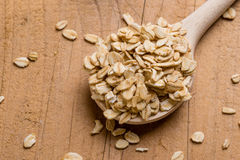 Oat flakes with wooden spoon Royalty Free Stock Images