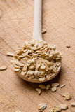Oat flakes with wooden spoon Stock Photo