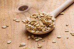 Oat flakes with wooden spoon Royalty Free Stock Image
