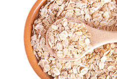 The oat flakes on a wooden spoon Stock Image