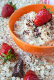 Oat flakes with yogurt and strawberries Stock Photography