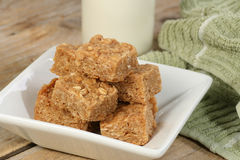 Oat flapjack pieces with milk Royalty Free Stock Photos