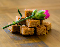 Oat Flapjacks and thistle on oak table Royalty Free Stock Image