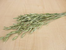 Oat florets on wooden board Royalty Free Stock Photography